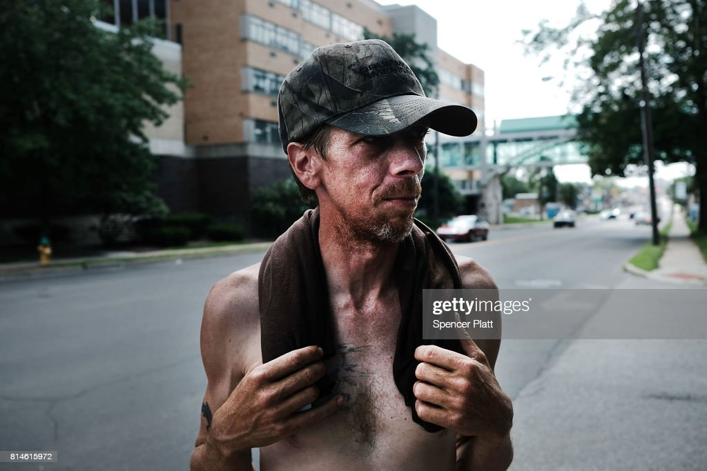 A man walks through the streets of Warren on July 14, 2017 in Warren, Ohio. Warren, a city that was once one of the nation's manufacturing hubs, has been struggling with high unemployment and a surge in opioid addiction.