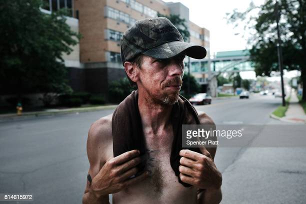 A man walks through the streets of Warren on July 14 2017 in Warren Ohio Warren a city that was once one of the nation's manufacturing hubs has been...
