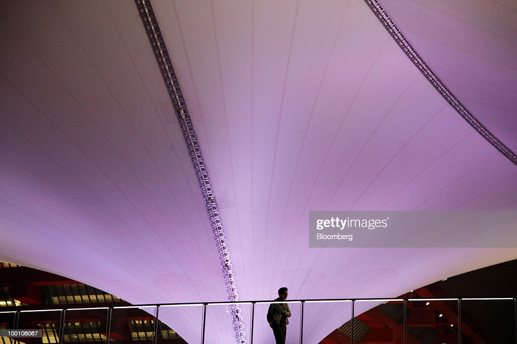 A man walks through the the 2010 World Expo site in Shanghai, China, on Thursday, May 20, 2010. The 2010 World Expo will take place until October 31. Photographer: Qilai Shen/Bloomberg via Getty Images