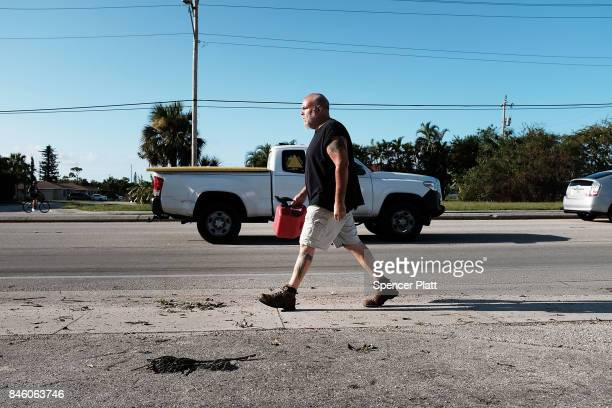 A man walks to a gas station two days after Hurricane Irma swept through the area on September 12 2017 in Cape Coral Florida Hurricane Irma made...