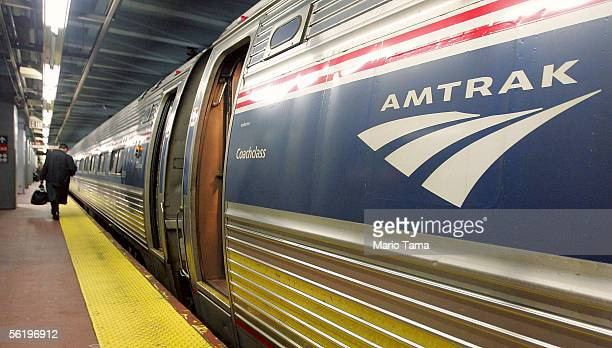 A man walks to board an Amtrak train in Penn Station November 17 2005 in New York City Transportation Secretary Norman Y Mineta said today that the...