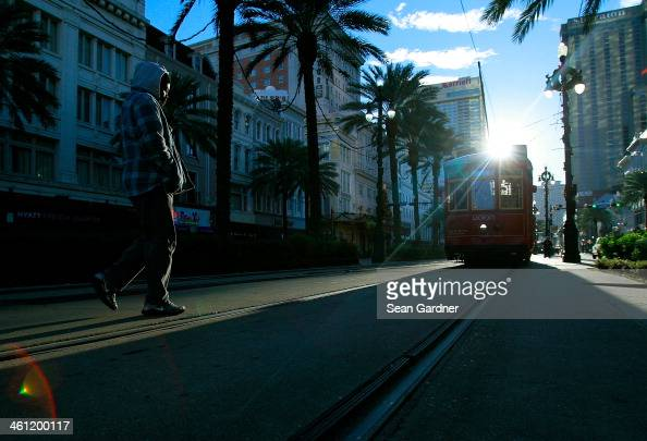 A man walks to catch the Street Car on Canal Street as temperatures in the area plummeted below freezing on January 7 2014 in New Orleans Louisiana...
