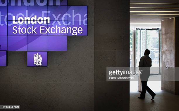 A man walks to the lifts inside The London Stock Exchange on August 5 2011 in London England The Eurozone debt crisis has caused further falls in...
