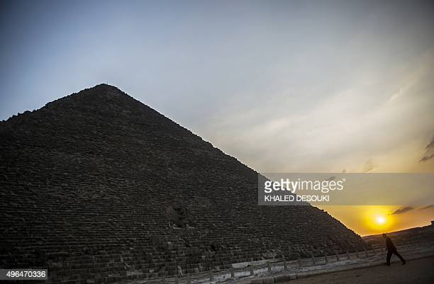 A man walks to wards Giza's Pyramid of Khufu on the southern outskirts of Cairo on November 9 2015 Moscow acknowledged on November 10 2015 for the...