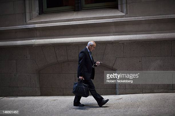 A man walks to work near Wall Street and the New York Stock Exchange June 5 2012 in New York City