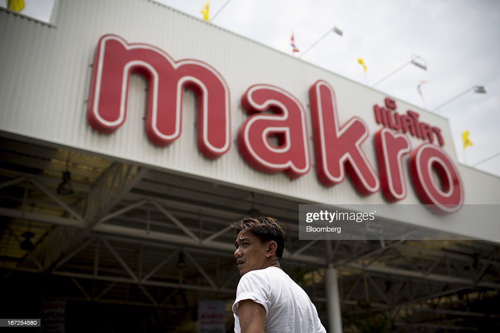 A man walks towards a Makro store, operated by Siam Makro Pcl, in Bangkok, Thailand, on Tuesday, April 23, 2013. Billionaire Dhanin Chearavanont's CP All Pcl, Thailand's 7-Eleven chain, offered to pay about $6.6 billion for discount retailer Siam Makro Pcl in the biggest takeover announced in Asia this year. Photographer: Brent Lewin/Bloomberg via Getty Images