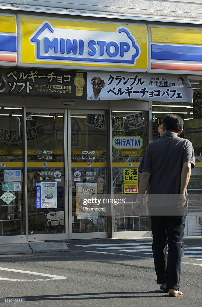 A man walks towards a Ministop Co. convenience store in Yokohama City, Kanagawa Prefecture, Japan, on Tuesday, Sept. 11, 2012. Sales at Japan's convenience stores declined 3.3 percent in July from a year ago on a same-store basis, according to the Japan Franchise Association. Photographer: Akio Kon/Bloomberg via Getty Images