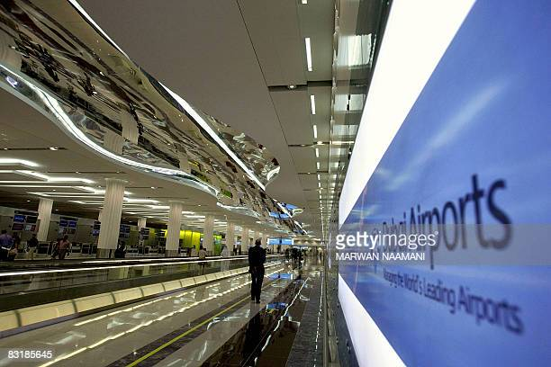 A man walks towards the departure laounge at Dubai International Airport's new Terminal 3 on October 9 2008 The fast growing emirate of Dubai...