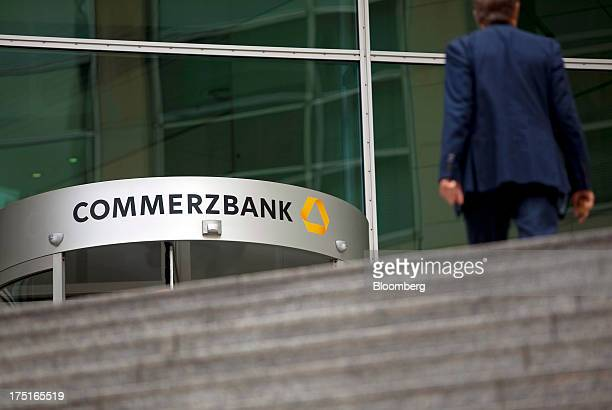 A man walks towards the headquarters of Commerzbank AG Germany's secondbiggest bank in Frankfurt Germany on Wednesday July 31 2013 The Frankfurtbased...