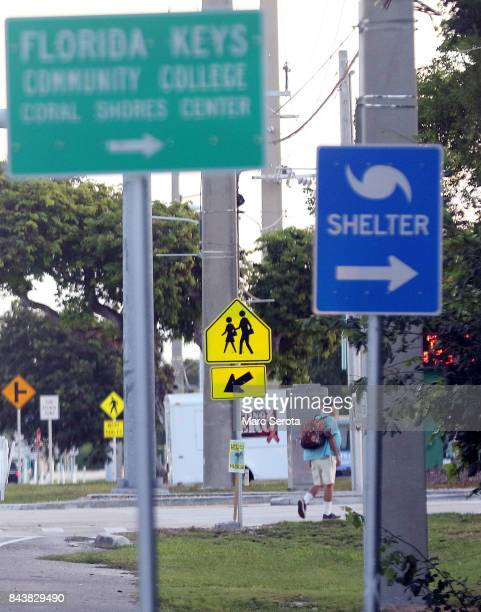 A man walks towars the shelter at Coral Shores High School on Overseas Highway as mandatory evacuations continue in Monroe County and the Florida...