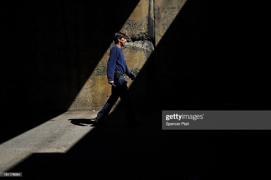 A man walks under a bridge in the South Bronx on September 19, 2013 in New York City. According to the 2010 U.S. Census Bureau report, over a quarter-million people in the South Bronx are living in poverty, making the 16th Congressional District the poorest in the nation. New Census Bureau numbers for all of New York City show that the poverty rate has risen to 21.2 percent in 2012, from 20.9 percent the year before. As New Yorkers prepare to vote for their next mayor following Michael Bloomberg, the Democratic candidate Bill de Blasio has focused on the theme that New York has transformed into a 'tale of two cities' under the Bloomberg administration.