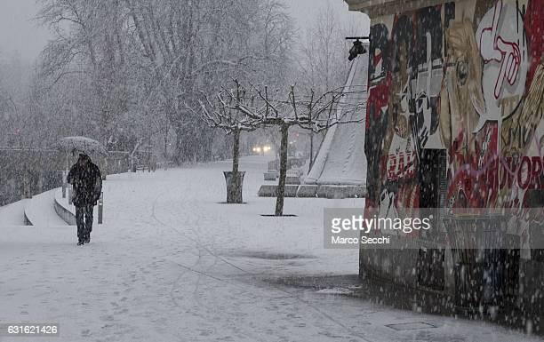 A man walks under heavy snow along the bank of river Ljubljanica on January 13 2017 in Ljubljana Slovenia Most of Slovenia was covered by heavy...