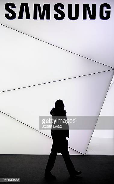 A man walks under the logo of Samsung at the 2013 Mobile World congress in Barcelona on February 25 2013 The 2013 Mobile World Congress the world's...