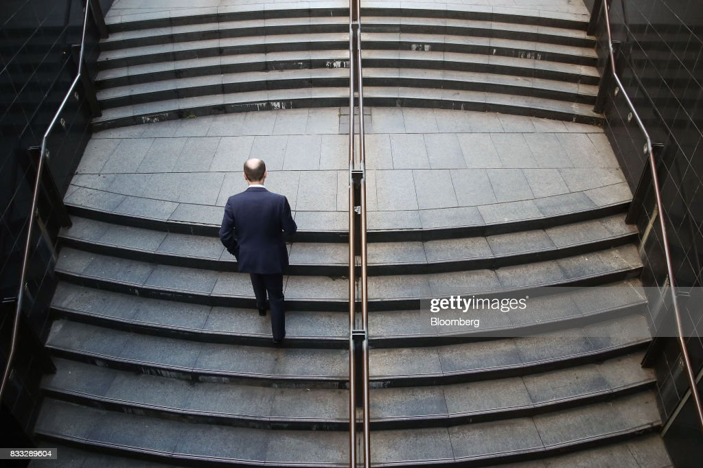 A man walks up a flight of stairs at Martin Place in Sydney, Australia, on Thursday, Aug. 17, 2017. Australian employers added more jobs than forecast in July, underscoring the central banks confidence in an improving labor market. Photographer: Brendon Thorne/Bloomberg via Getty Images