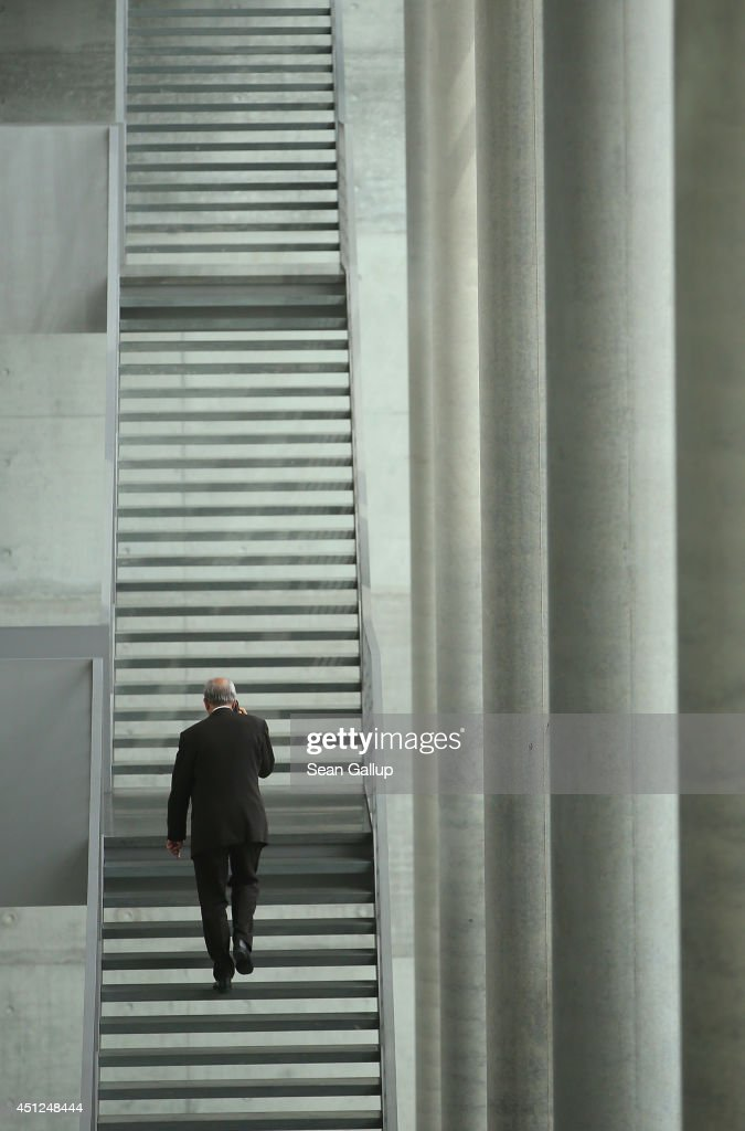 A man walks up stairs at Paul-Loebe-Haus on June 26, 2014 in Berlin, Germany. The building houses offices of members of the German parliament, the Bundestag.
