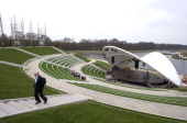 A man walks up stairs on the site of the Floriade 2012 during final preparations prior to the start of the World Horticultural expo in Venlo on March...
