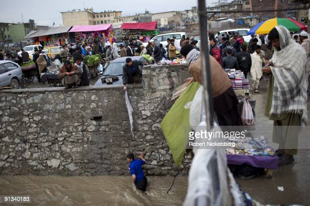 A man walks up the Kabul River searching for a dropped item in the downtown market area of Kabul Afghanistan April 6 2009 Kabul has an estimated...