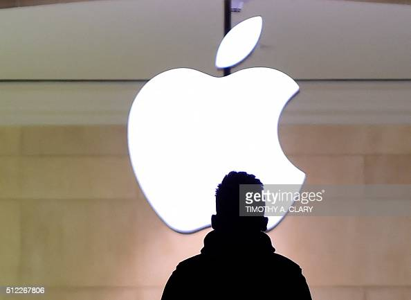 A man walks up the stairs at the Apple Store in Grand Central Station February 25 2016 Apple has been in a legal fight with the government in the San...