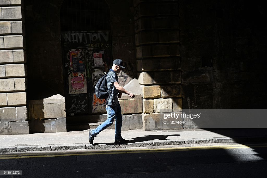 A man walks walks under a road bridge in the Old Town area of Edinburgh, Scotland on June 25, 2016. Scotland wants immediate talks with the European Union on protecting its place in the bloc, after Britain's vote to leave the EU, First Minister Nicola Sturgeon said Saturday. Speaking after an emergency meeting of her cabinet, Sturgeon said it had agreed to seek 'immediate discussions with the EU institutions and other EU member states to explore all possible options to protect Scotland's place in the EU.' SCARFF