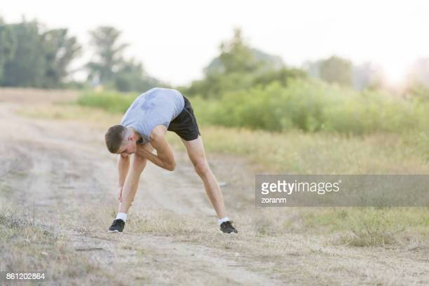Man warming up before going for a jog