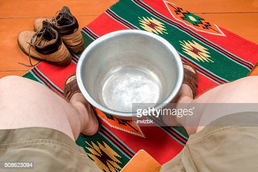 Man warms his feet in a basin of water : Stock Photo