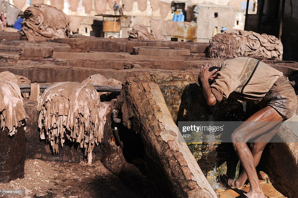 A man washes himself after work at the tanneries in Fes on November 21, 2012. AFP / PHOTO / FADEL SENNA