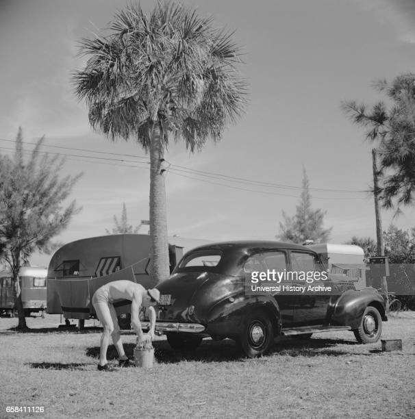 Man Washing Car at Trailer Park Sarasota Florida USA Marion Post Wolcott for Farm Security Administration January 1941