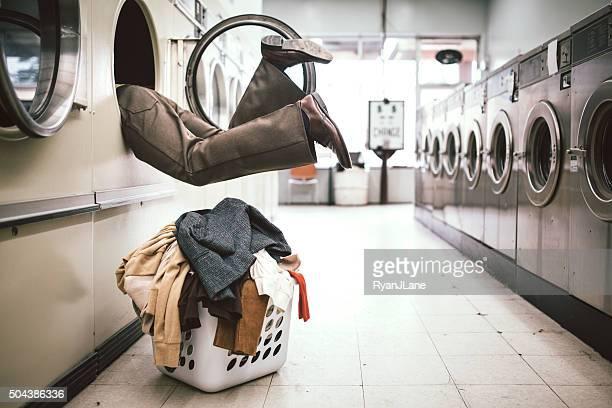 Man Washing Clothes at Laundromat