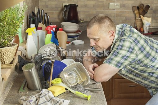 Man Washing Dirty Dishes In The Kitchen Sink Stock Photo | Thinkstock