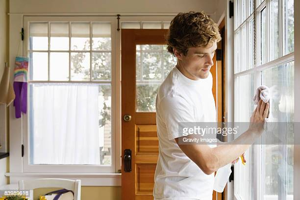 Man Washing House Windows