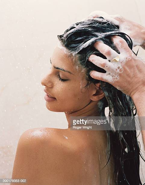 Man washing young woman's hair, close-up