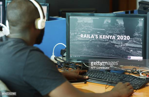 A man watches a campaign ad that was unleashed on the internet this week in Kenya just weeks before national elections on July 13 in Nairobi The 90...
