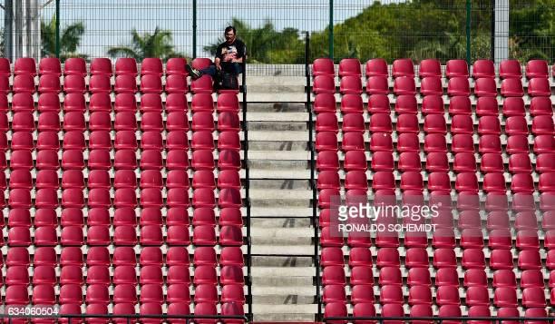 A man watches a Caribbean Baseball Series match between Aguilas del Zulia of Venezuela and Criollos de Caguas of Puerto Rico at the Tomateros stadium...