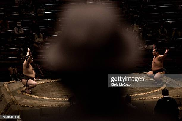 A man watches a fight during the Tokyo Grand Sumo tournament at the Ryogoku Kokugikan on September 17 2015 in Tokyo Japan Japanese Sumo is an anciant...
