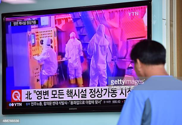 A man watches a news report at a railway station in Seoul on September 15 on the confirmation from North Korea that the nuclear reactor seen as the...