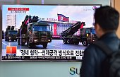 A man watches a news report showing file footage of North Korean missiles on parade at a railway station in Seoul on March 4 2016 North Korean leader...