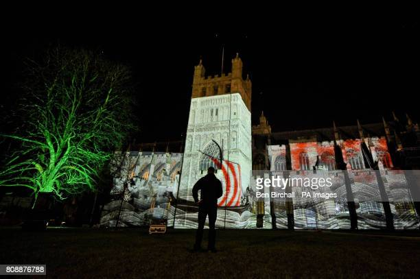 A man watches a projected animation on the side of Exeter Cathedral as part of the Animated Exeter Film Festival where artworks will depict the...