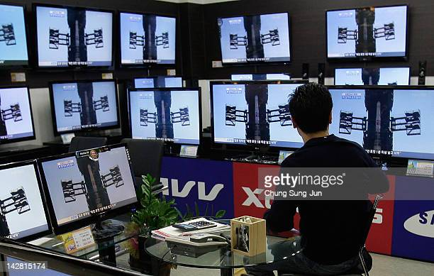 A man watches a television broadcast reporting the North Korea launched the longrange missile at the Yongsan electronic market on April 13 2012 in...