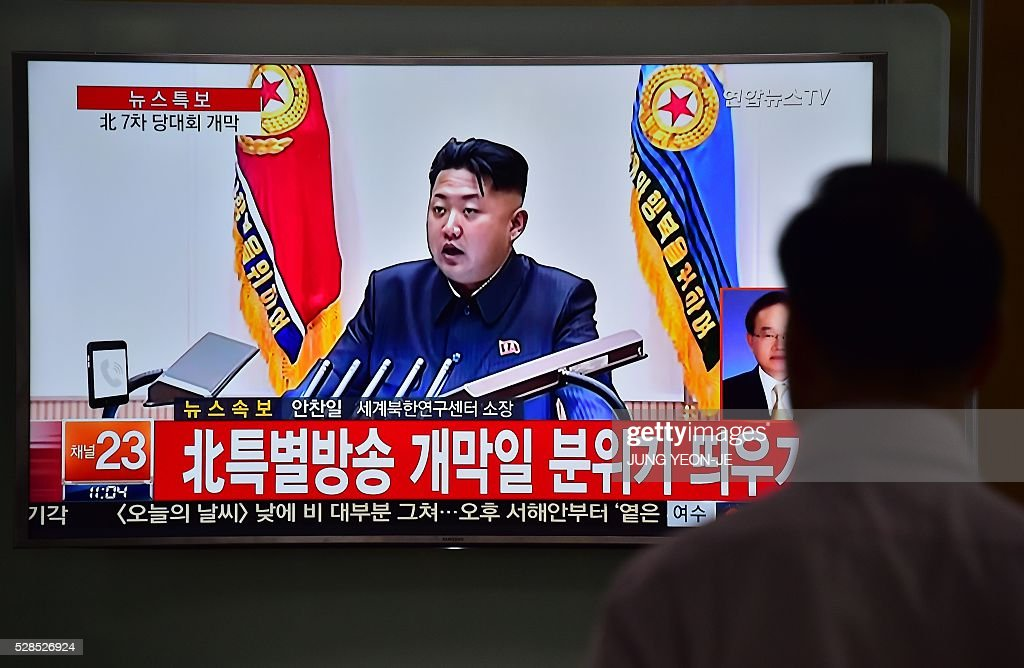 A man watches a television news broadcast showing file footage of North Korean leader Kim Jong-Un, at a railway station in Seoul on May 6, 2016. North Korea raised the curtain on May 6 on its biggest political show for a generation, aimed at cementing the absolute rule of leader Kim Jong-Un and shadowed by the possibility of an imminent nuclear test. / AFP / JUNG
