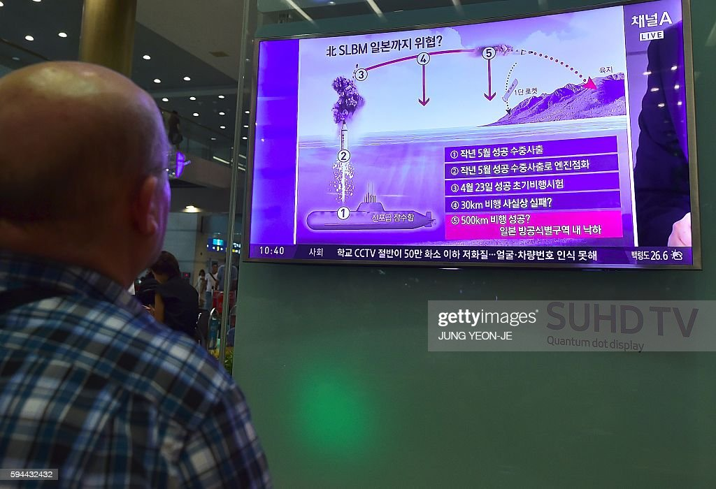 A man watches a television news reporting on North Korea's missile launch at Incheon airport west of Seoul on August 24 2016 North Korea testfired a...