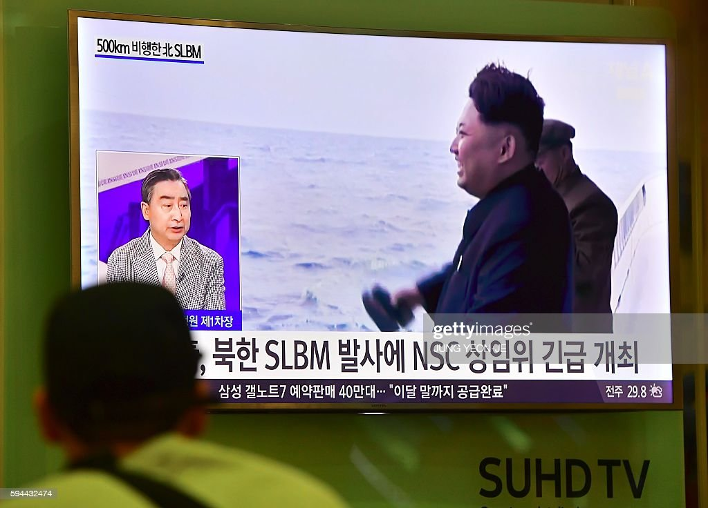 A man watches a television news showing file footage of North Korea's leader Kim JongUn during a missile launch at Incheon airport west of Seoul on...