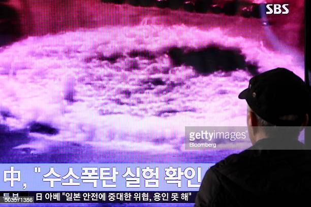 A man watches a television screen showing a news broadcast on North Korea's nuclear test at Seoul Station in Seoul South Korea on Wednesday Jan 6...