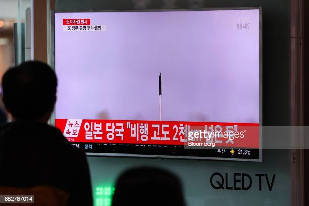 A man watches a television screen showing a news broadcast on North Korea's ballistic missile launch at Seoul Station in Seoul South Korea on Sunday...