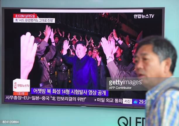 A man watches a television screen showing a video footage of North Korean leader Kim JongUn during the North's latest test launch of an...