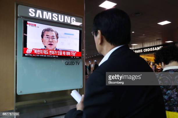 A man watches a television screen showing Moon Jaein South Korea's president during a news broadcast on North Korea's ballistic missile launch at...