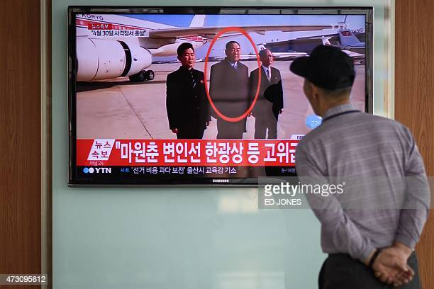 A man watches a television showing news coverage of the reported execution of North Korea's defence minister Hyon YongChol at a railway station in...