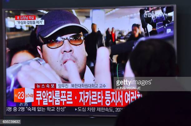 A man watches a television showing news reports of Kim JongNam the halfbrother of North Korean leader Kim JongUn in Seoul on February 14 2017 Kim...
