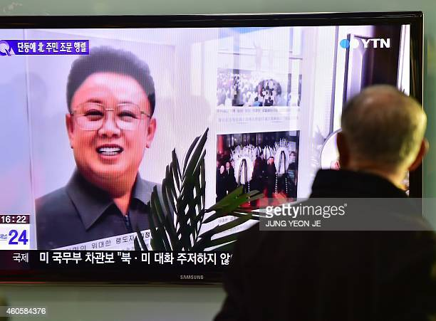 A man watches a TV news reporting on the third anniversary of North Korean leader Kim JongIl's death at a railway station in Seoul on December 17...