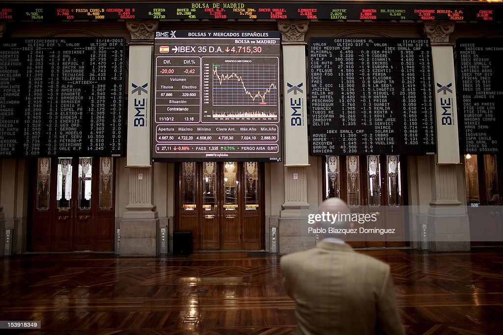 A man watches at stock prices information displayed on screens inside the Madrid Stock Exchange, or Bolsa y Mercado, on October 11, 2012 in Madrid, Spain. Ratings agency Standard & Poor's has cut Spain's credit rating from BBB+ down to BBB-. The Spanish government has already introduced spending cuts and tax rises in an attempt to ease their debt and reduce their high unemployment levels. Spanish Economy Minister Luis de Guindos maintains that his country will not need to ask for a bailout.
