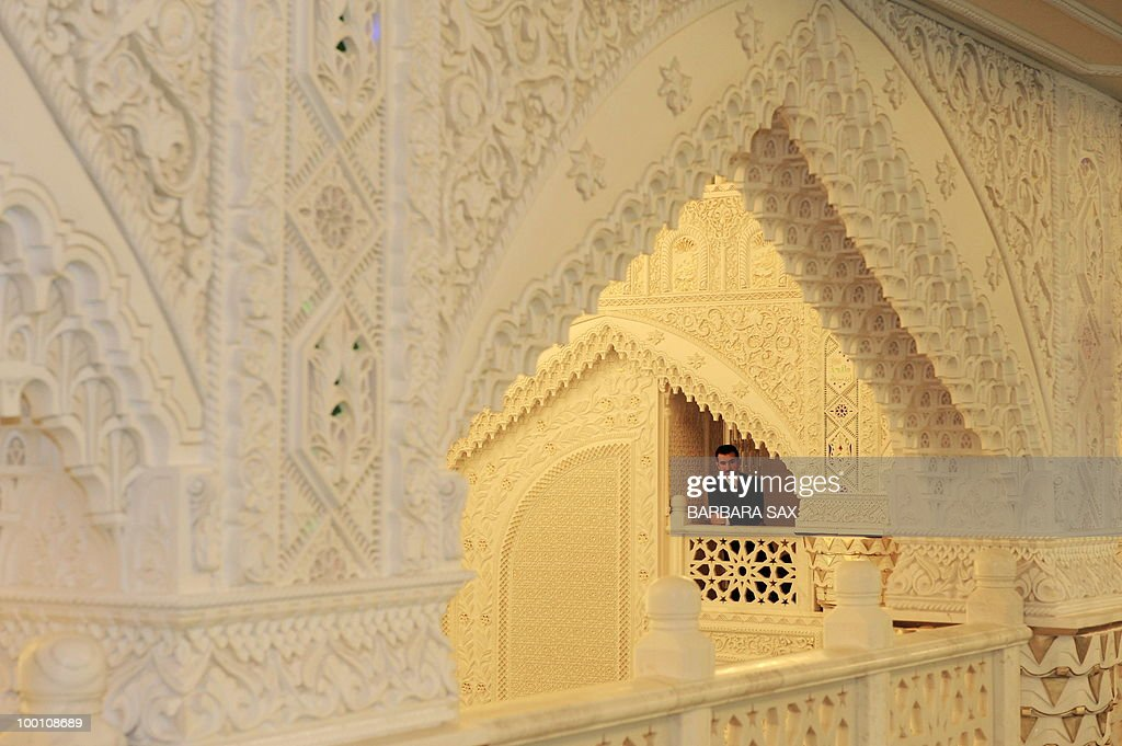 A man watches from a gallery of the new Omar Mosque in Berlin's Kreuzberg district during the inauguration of the Islamic Maschari Centre on May 21, 2010. The centre includes the mosque, a kindergarden, a school, a library, a travel agency and a shopping centre.